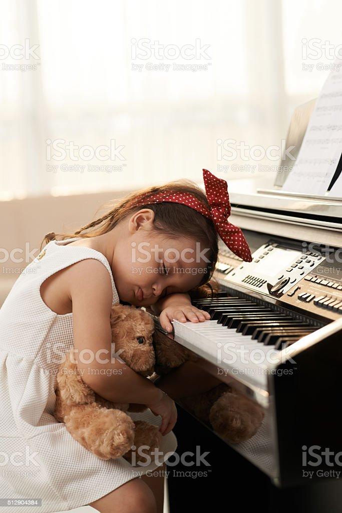 Fell asleep at piano stock photo