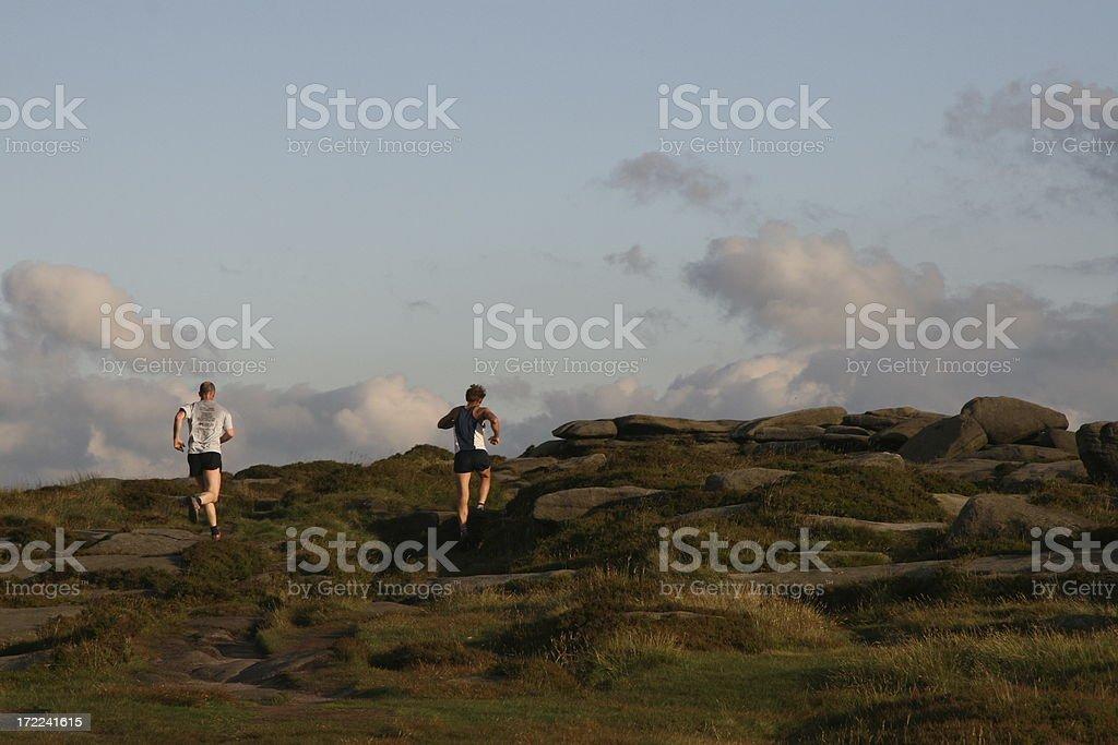 Fell runners Stanage Edge stock photo