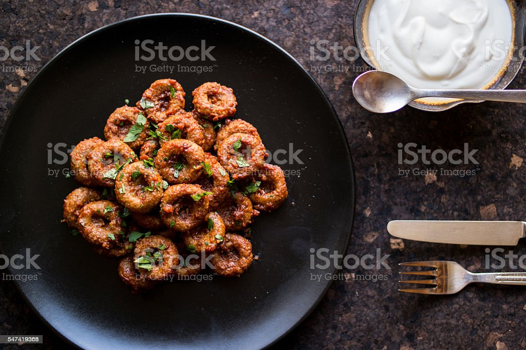 Fellah koftesi with yoghurt / bulgur meatball stock photo
