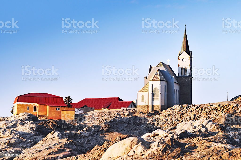 Felsenkirche and houses in the town of Luderitz in Namibia stock photo