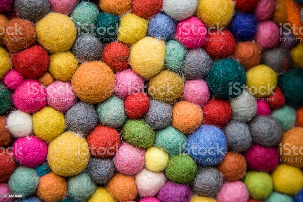 felt balls multi coloured texture stock photo