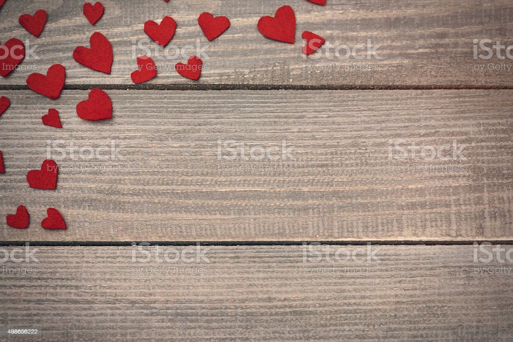 Felt hearts in the corner stock photo