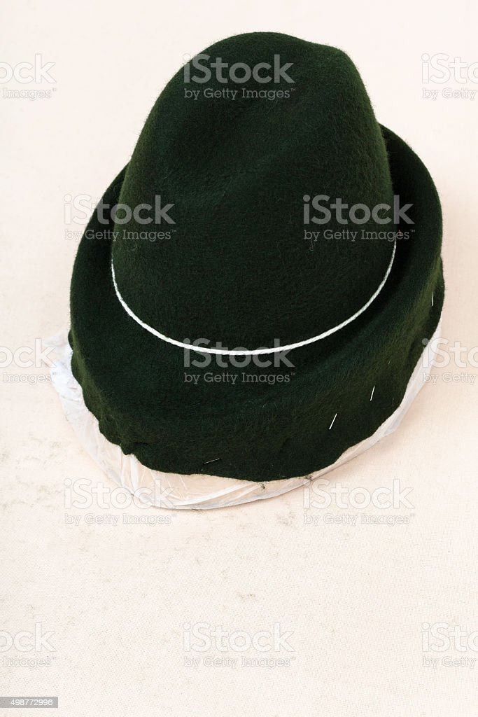 felt hood fixed on wooden hat-block for shaping stock photo