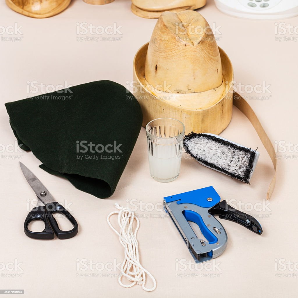 felt hood, wooden dummy and tools for millinery stock photo