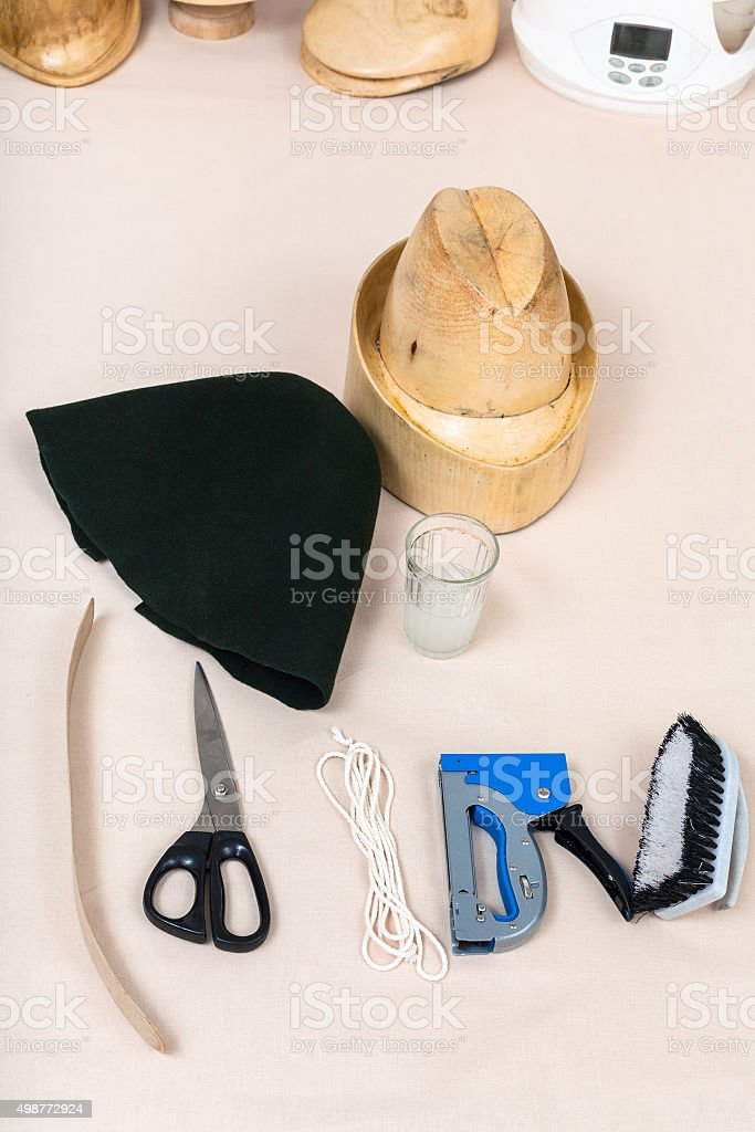 felt hood, wooden hat-block, tools for hatmaking stock photo