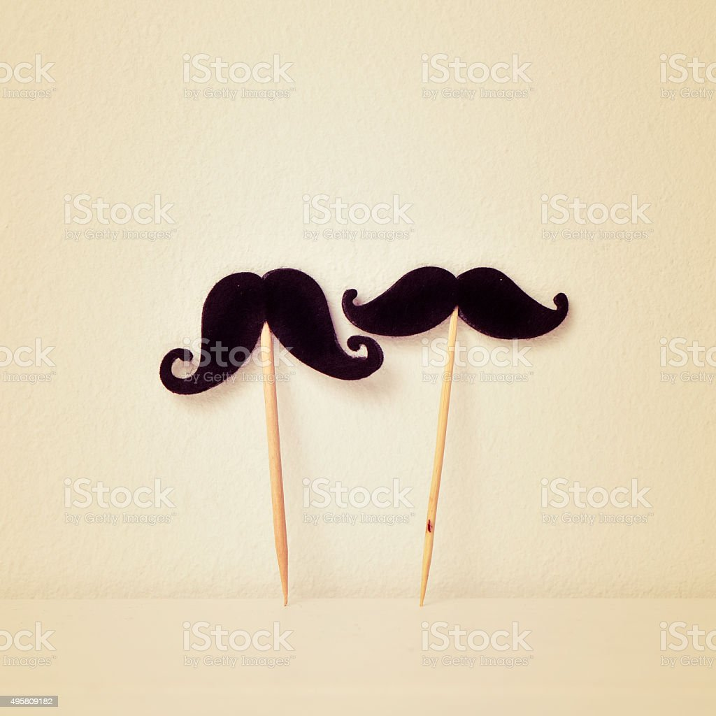 felt mustaches in sticks, retro effect stock photo
