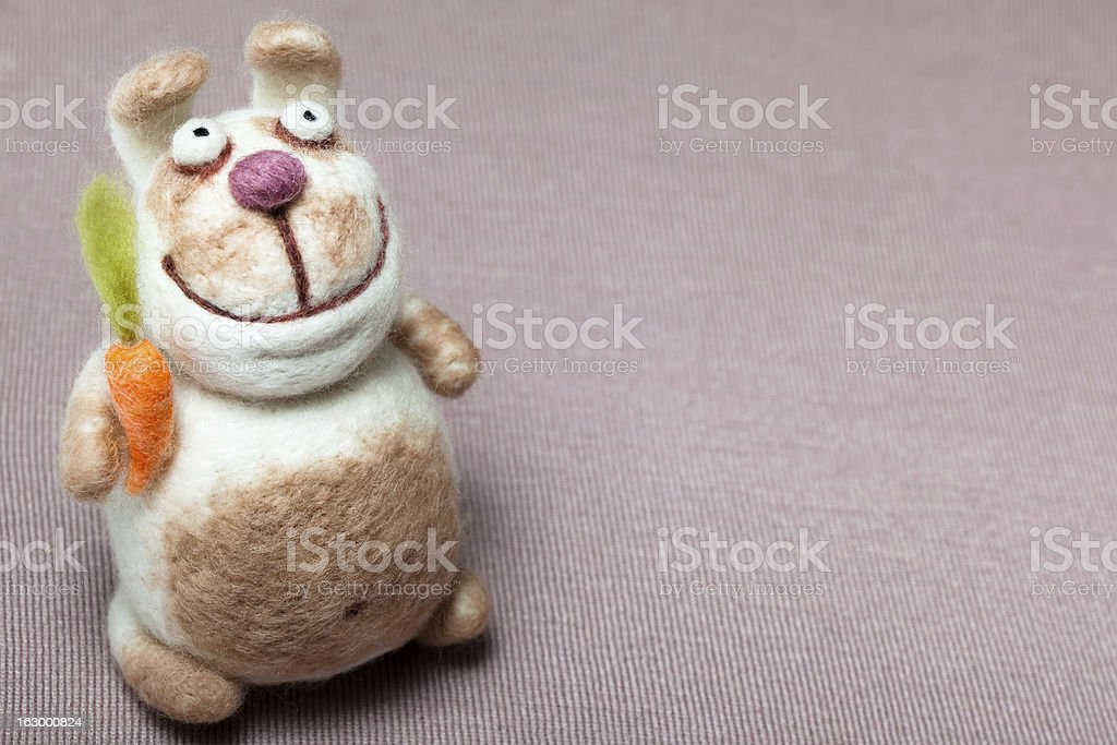 Felted Rabbit with Carrot stock photo