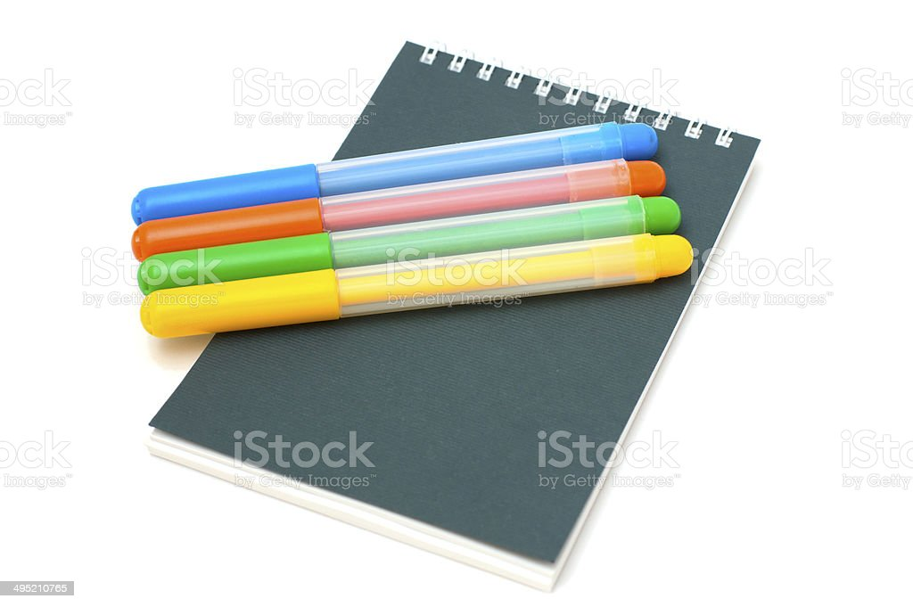 felt-tip pens on notebook stock photo