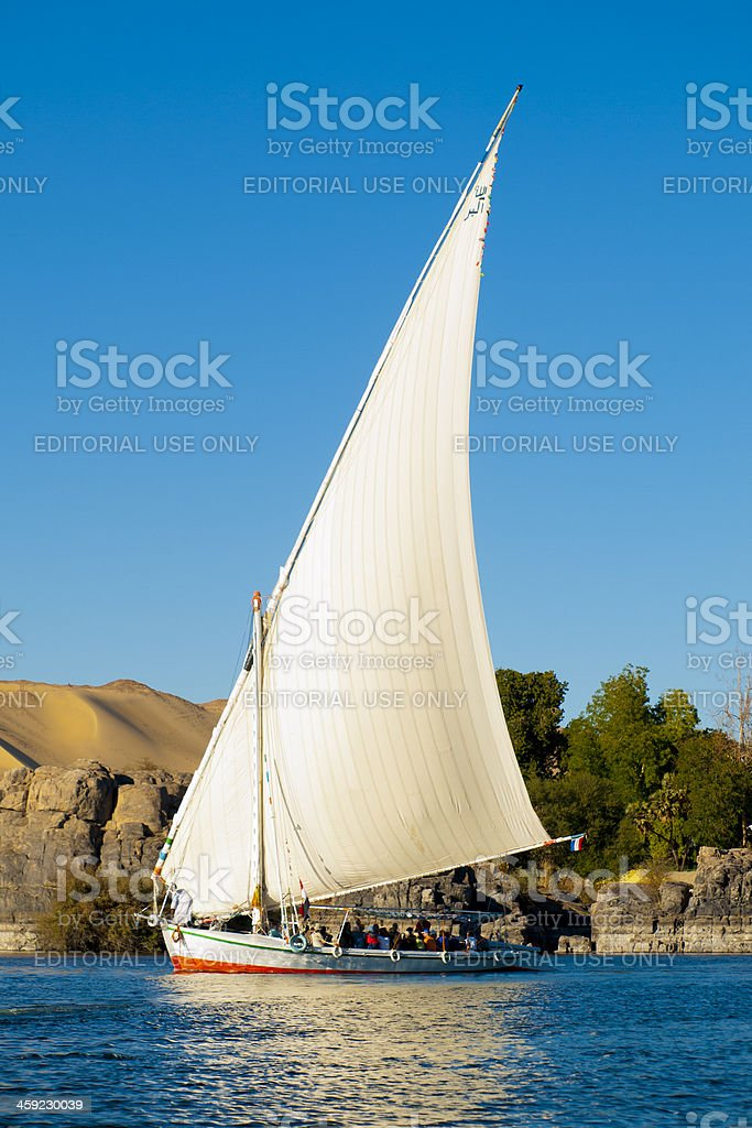 Felucca boat down the Nile River at Aswan in Egyp stock photo