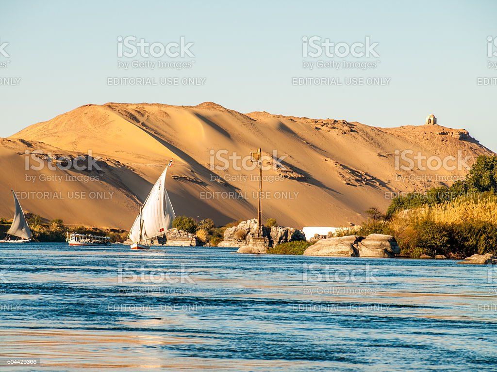Felucca boat down the Nile River at Aswan in Egypt stock photo