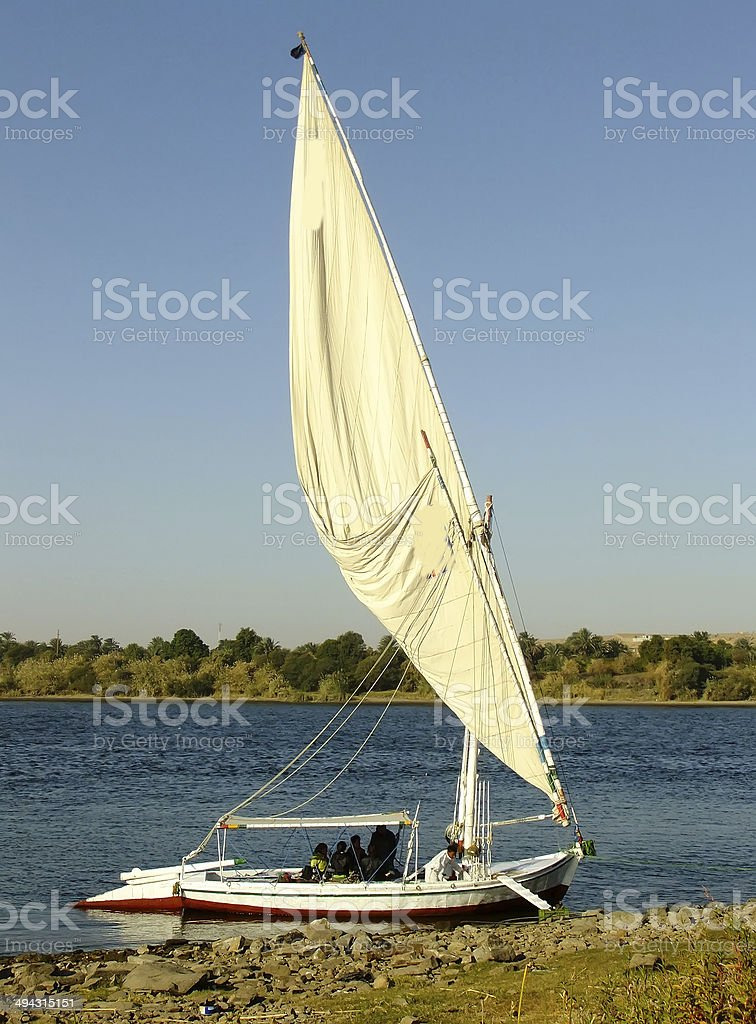 Felucca boat on the Nile river bank royalty-free stock photo