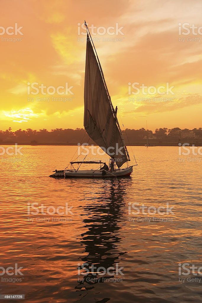Felucca boat sailing on the Nile river at sunset, Luxor royalty-free stock photo