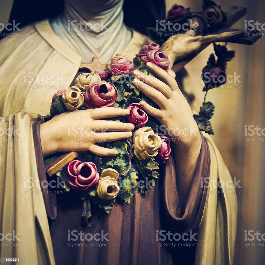 femaile saint holding a crucifix royalty-free stock photo