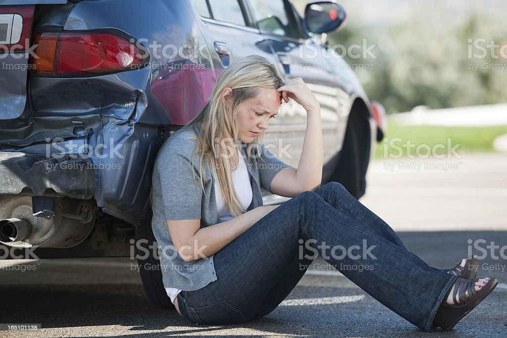 Femal Accident Victim Waits Outside of Her Car stock photo