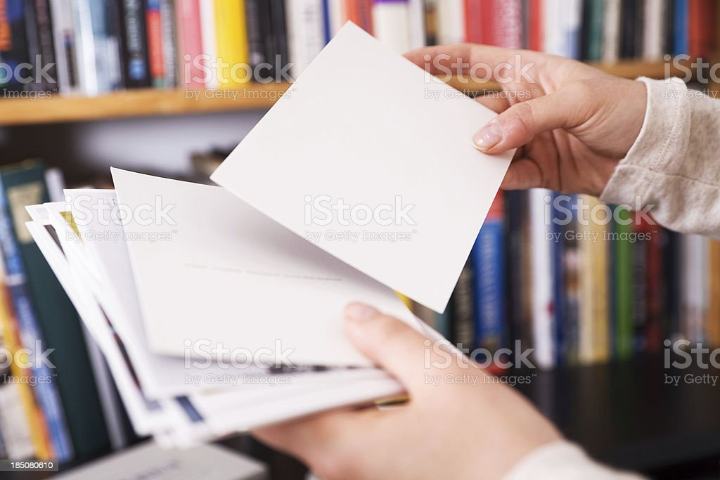 Femal hands holding postcards stock photo