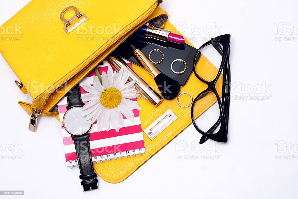 Female accessories in bag . Top view stock photo