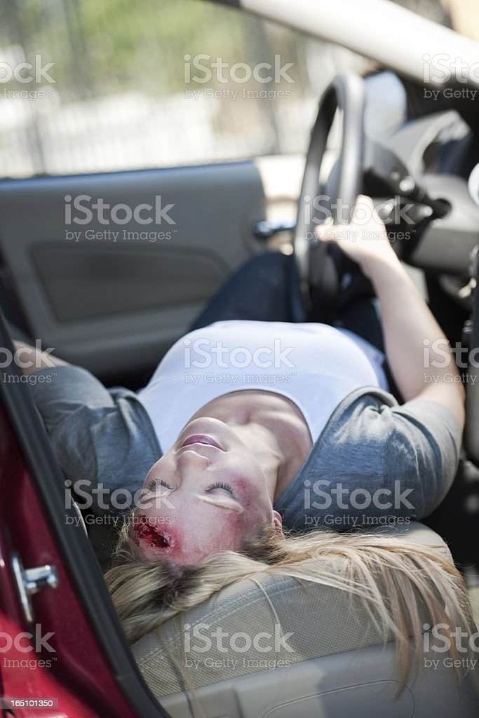 Female Accident Victim Unconscious in Front Seat of Car royalty-free stock photo