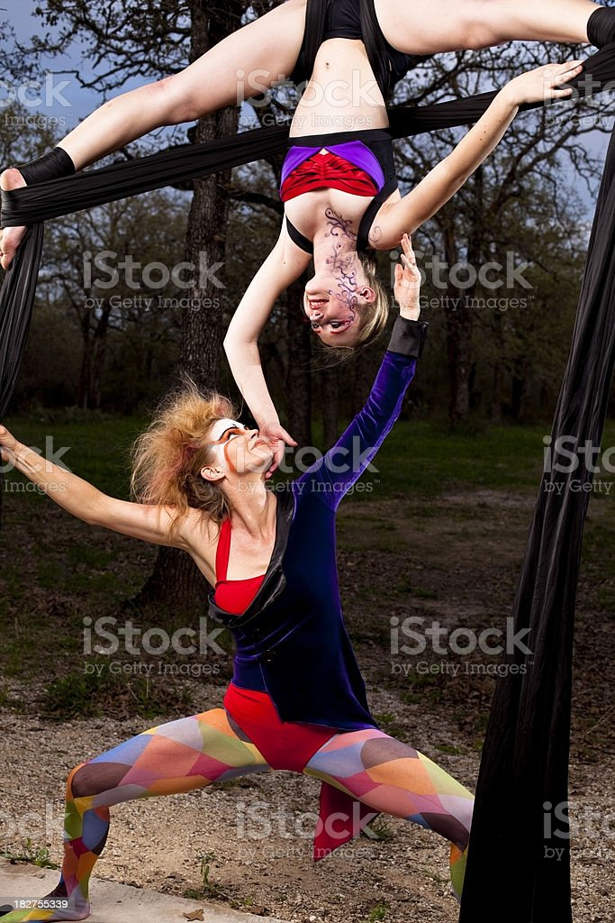 Female acrobats performing on silk ribbons royalty-free stock photo