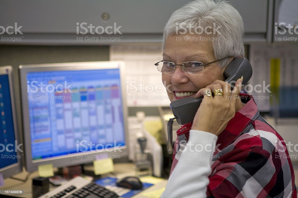 Female administrative specialist on the phone stock photo