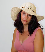 Female Adult In  A Straw Sun Hat