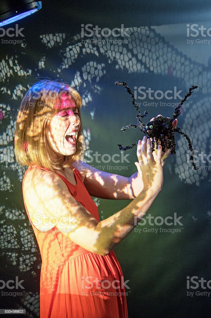 Female Adult Scared By A Spider stock photo