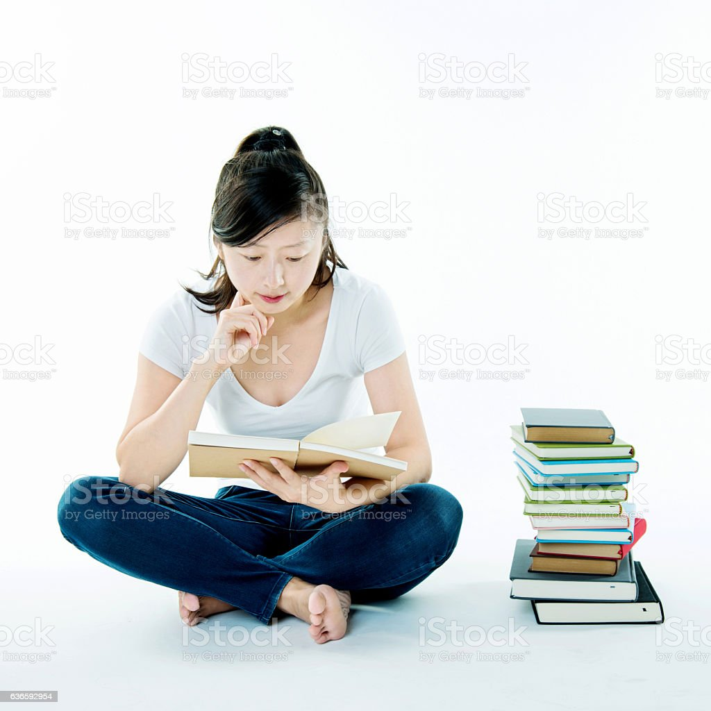 Female adult student sitting with books stock photo