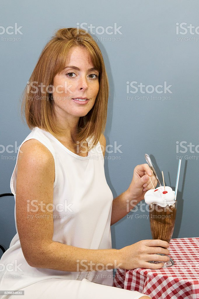 Female Adult With An Ice Cream Soda stock photo