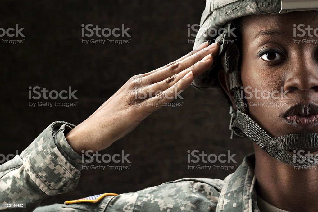 Female African American Soldier Series: Against Dark Brown Background stock photo