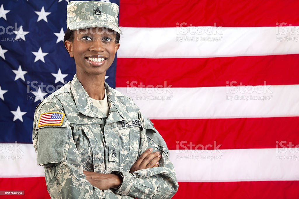 Female African American Soldier Series: Standing against USA Flag stock photo