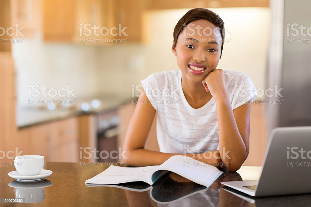 female african college student at home stock photo