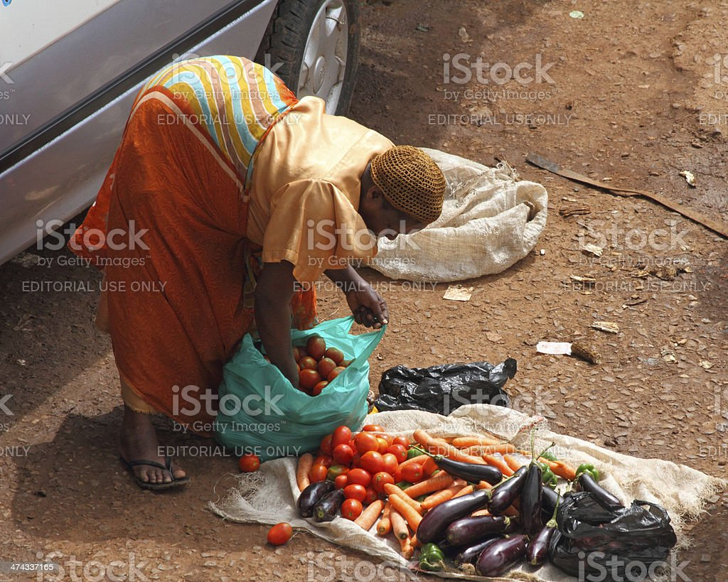 Female African Vegetable Vendor stock photo