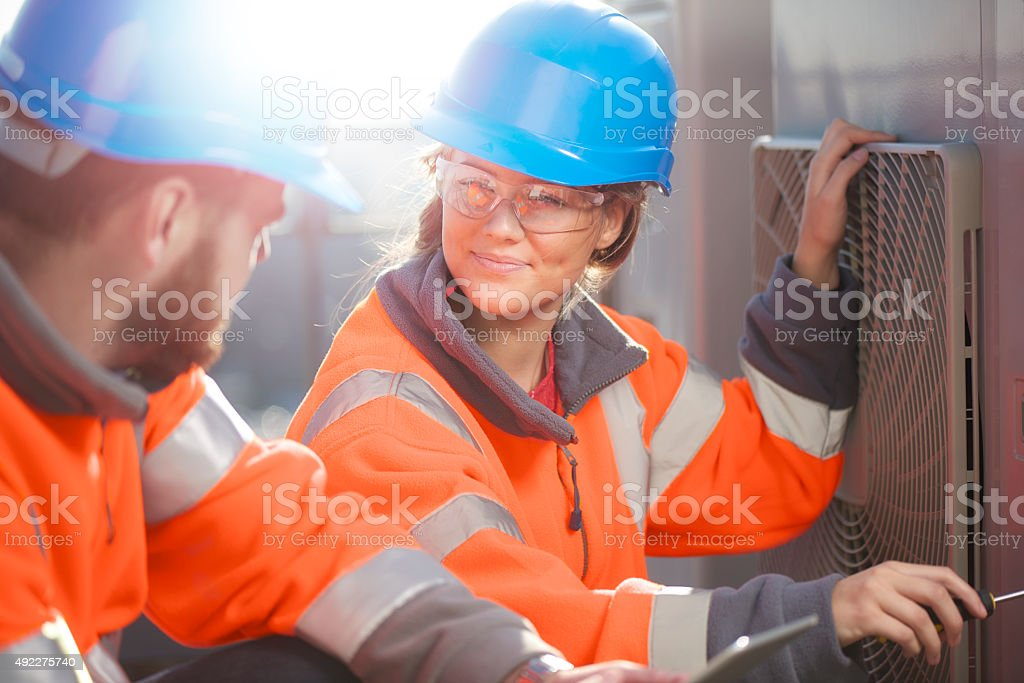 female air conditioning technician with her supervisor stock photo