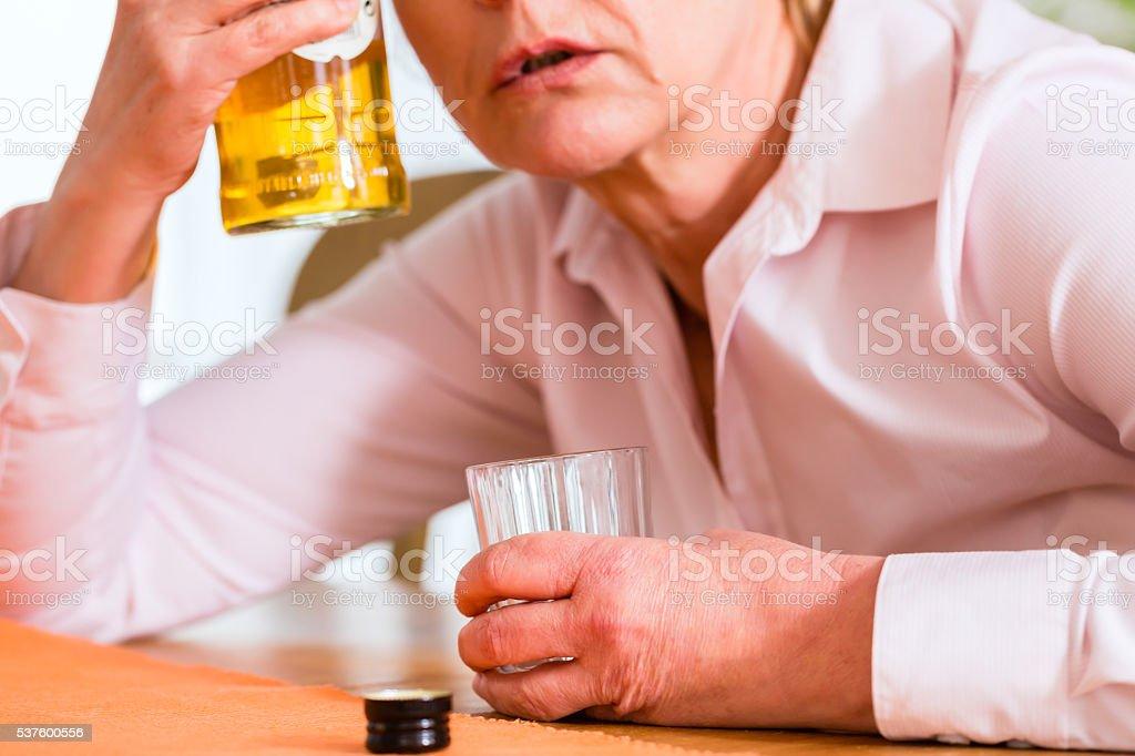 Female alcoholic drinking hard liquor stock photo