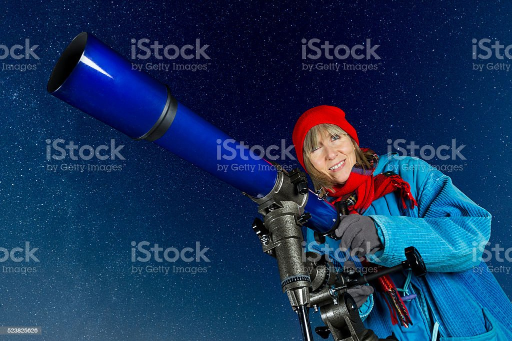 Female amateur astronomer stock photo
