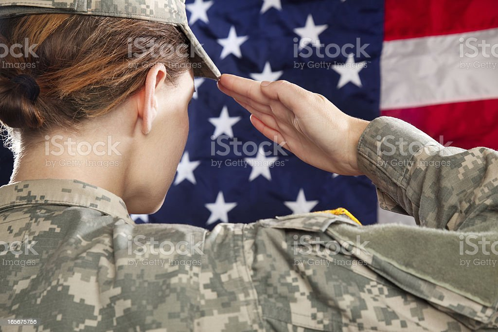 Female American Soldier Saluting stock photo