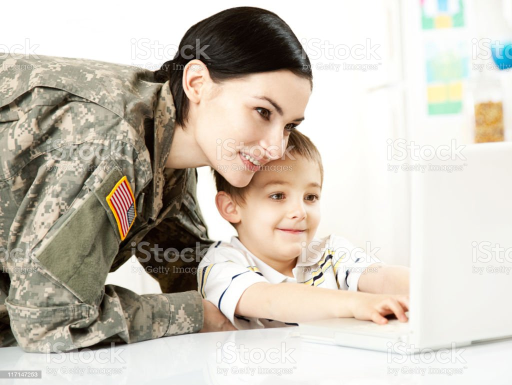 Female American Soldier with Son stock photo