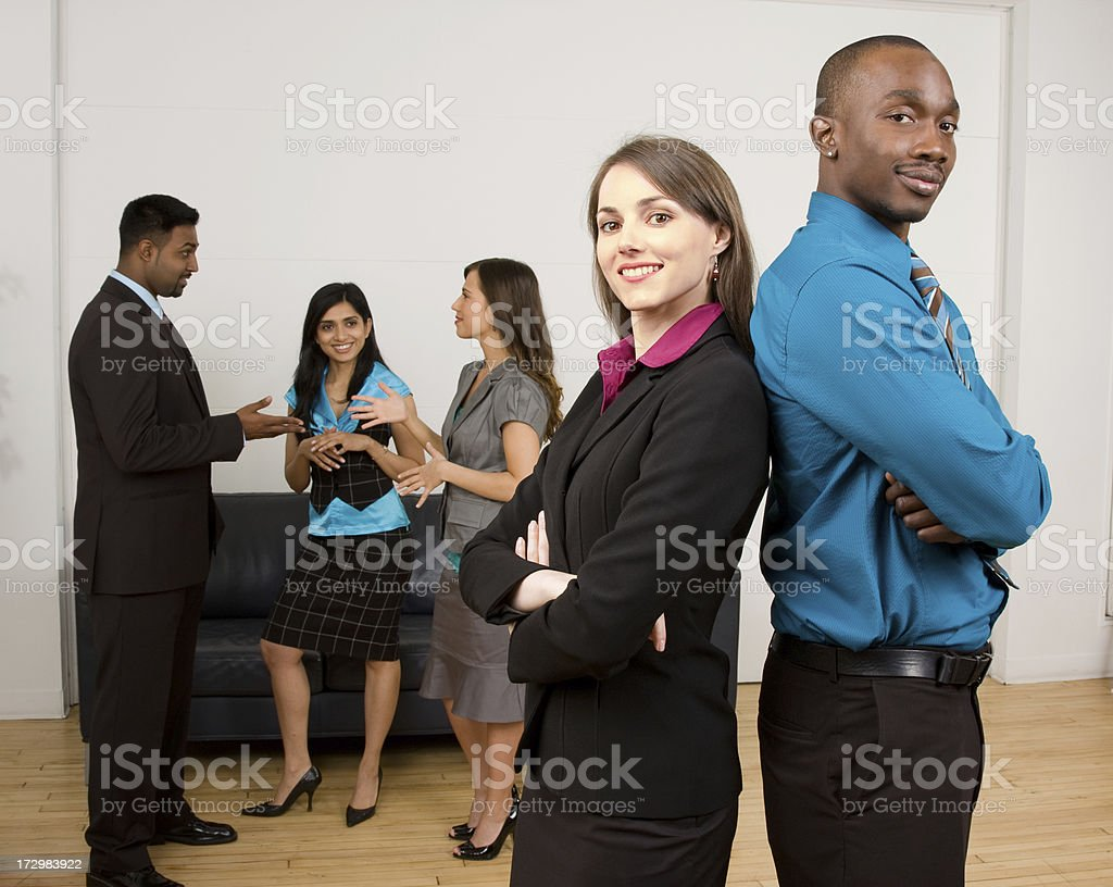 Female and Male business partners leading the team stock photo