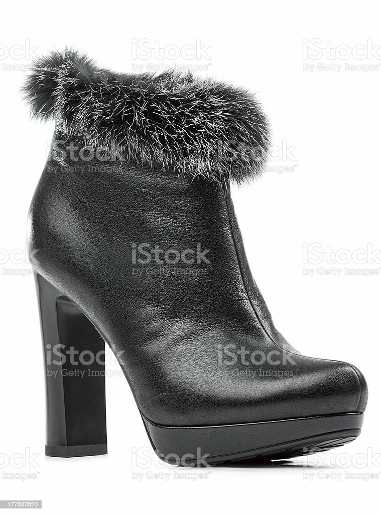 Female ankle-high boot isolated over white royalty-free stock photo