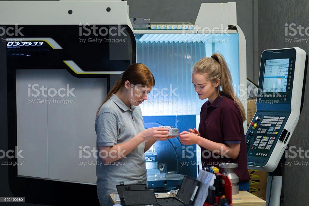 Female Apprentice in Engineering stock photo