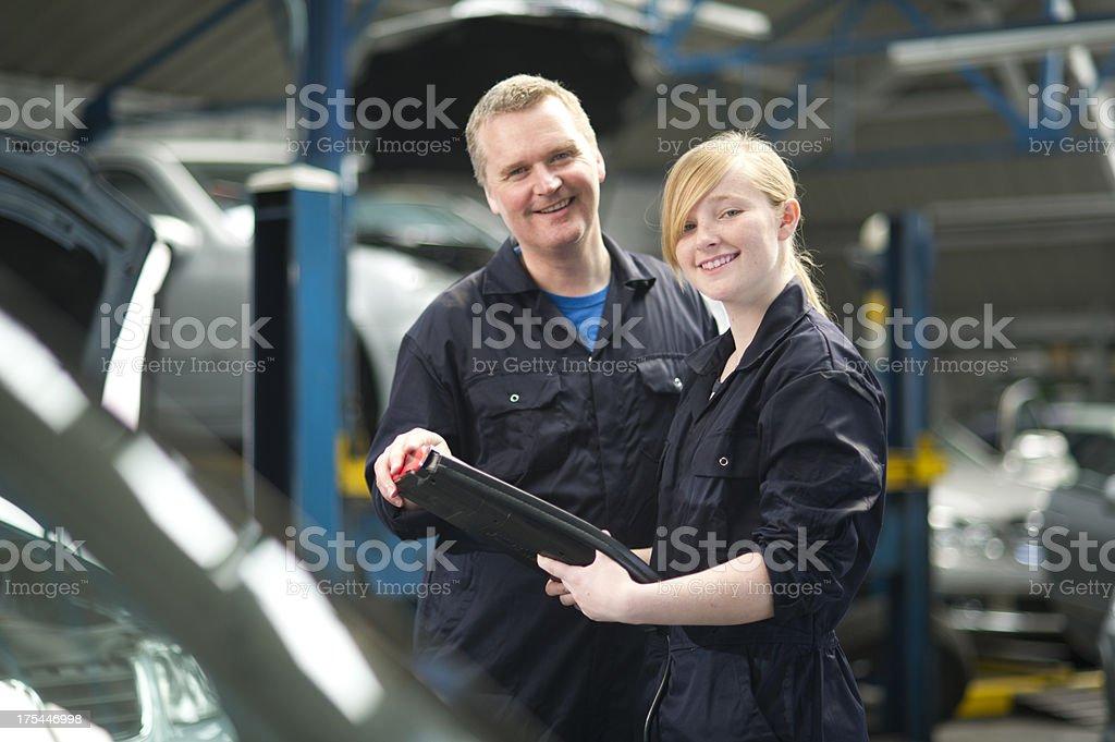 female apprentice mechanic royalty-free stock photo