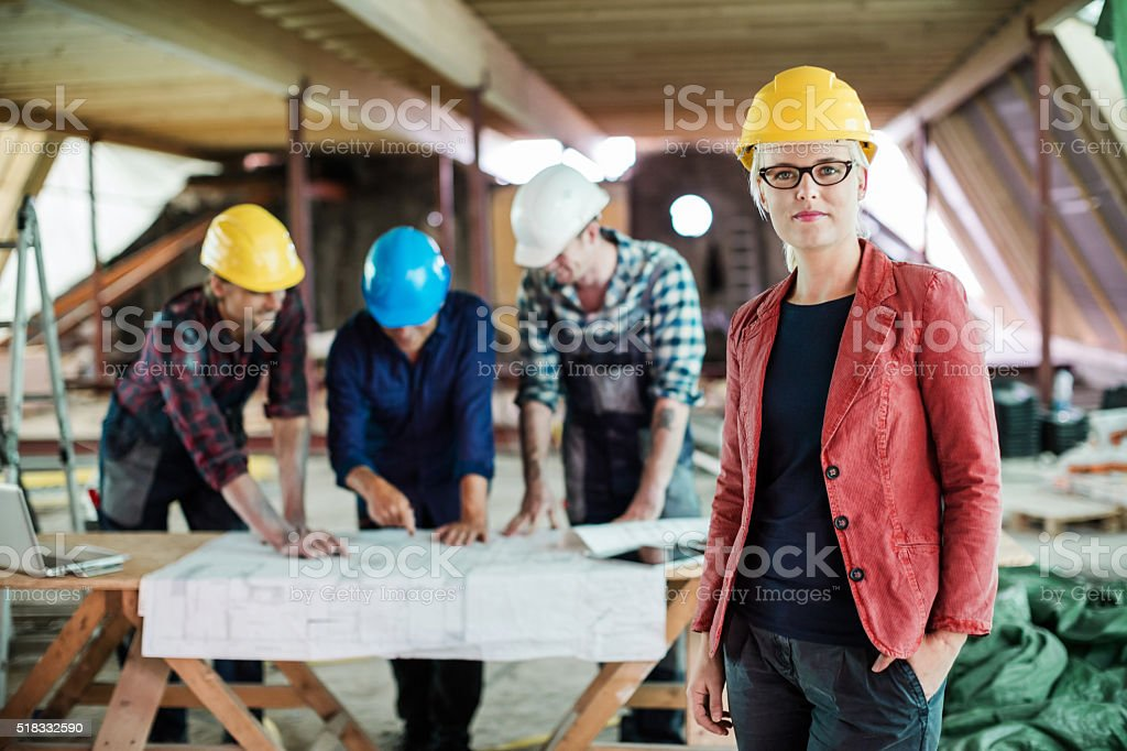 Female Architect And Construction Workers stock photo