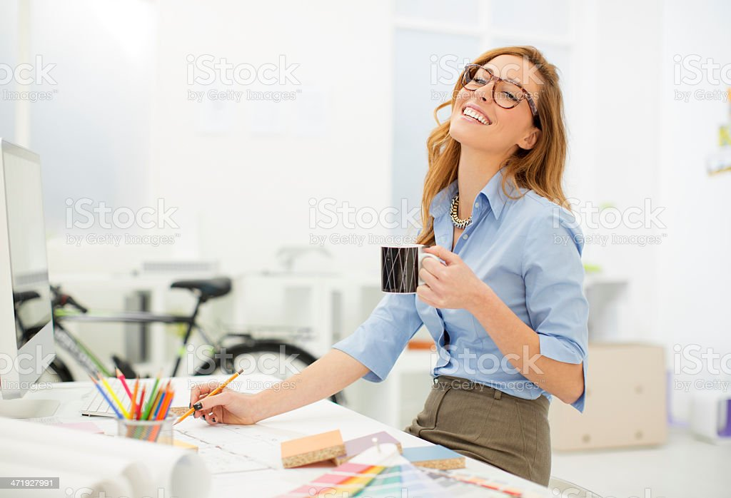 Female Architect At Work. stock photo