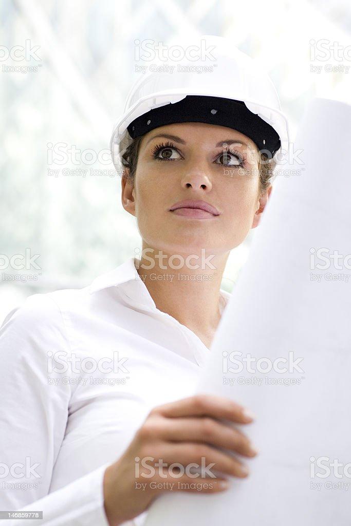Female architect holding blueprints royalty-free stock photo