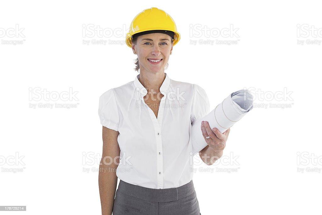 Female architect holding plans and hard hat royalty-free stock photo