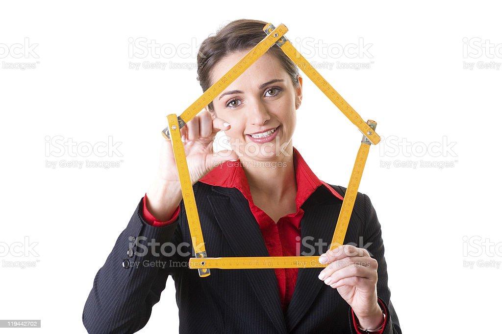 female architect holds house shape measure tape, design concept, isolated stock photo