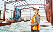 Female architect in construction site
