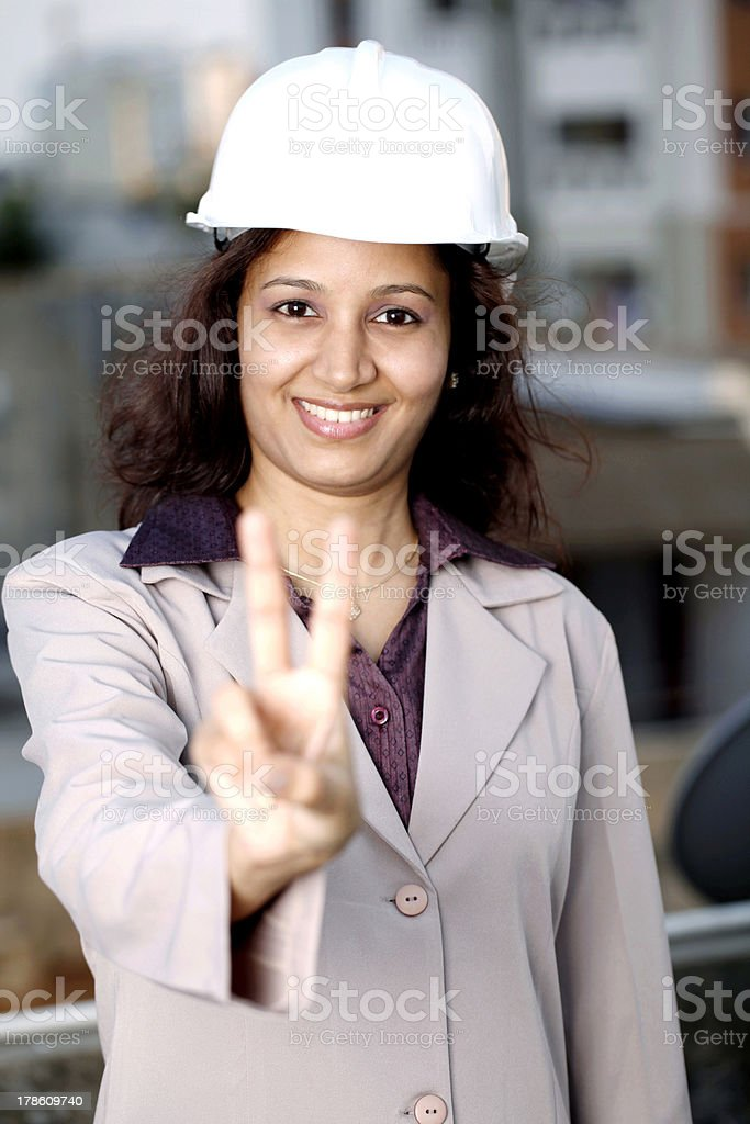 Female architect showing victory sign royalty-free stock photo