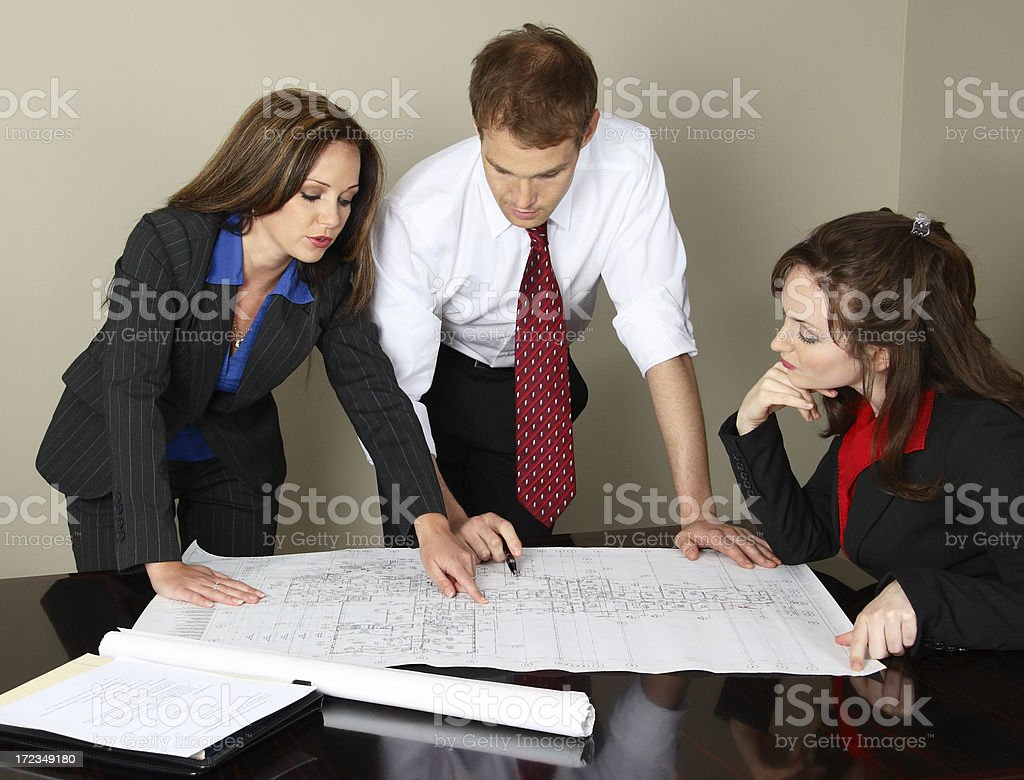 Female Architect Shows Plans To Client royalty-free stock photo