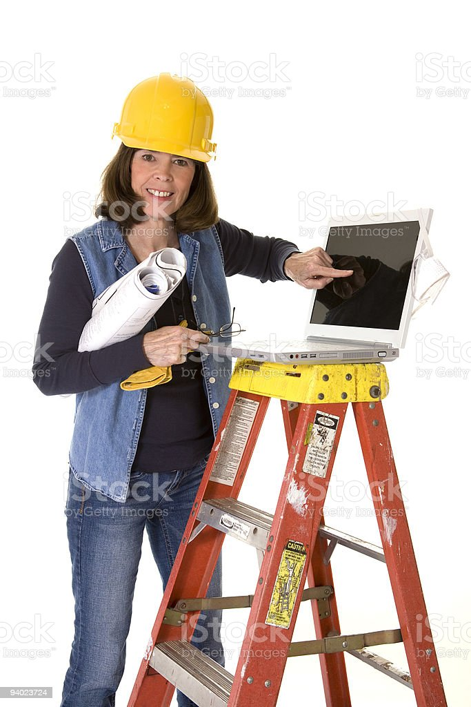 Female architect using computer and blueprints royalty-free stock photo