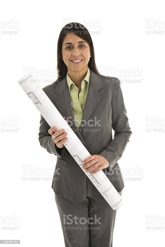 Female architect wearing suit holding blueprints royalty-free stock photo